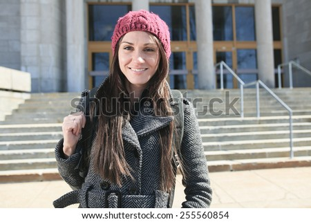 A Female student outside in the winter season - stock photo