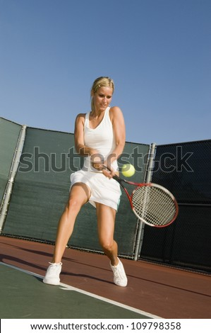 A female tennis player hitting a shot - stock photo
