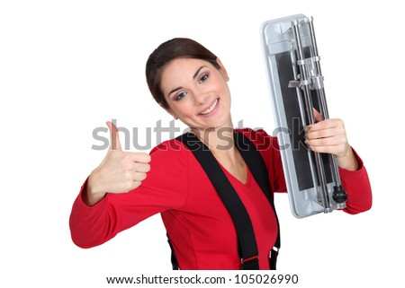 A female tiler giving the thumb up. - stock photo