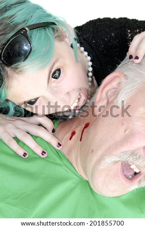A Female Vampire with Blue Hair and Black Eyes Bites an unsuspecting victim and drinks his blood for her dinner. On white with room for your text - stock photo
