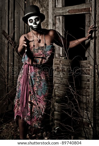a female voodoo priestess with face paint
