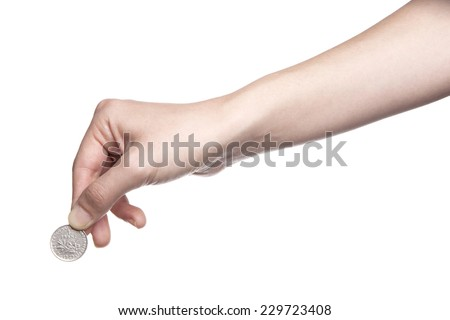 A female(woman) hand hold a coin isolated white at the studio. - stock photo