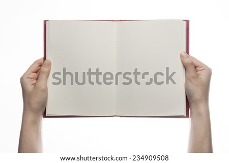 A female(woman) hand hold a empty(blank) book(diary, note) spread isolated white at the studio. - stock photo