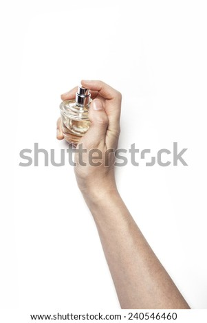 A female(woman) hand hold a perfume container isolated white at the studio.  - stock photo