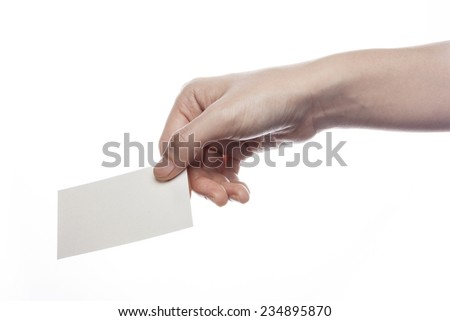 A female(woman) hand hold(pick up, give) a empty(blank) paper(business name card) isolated white at the studio. - stock photo