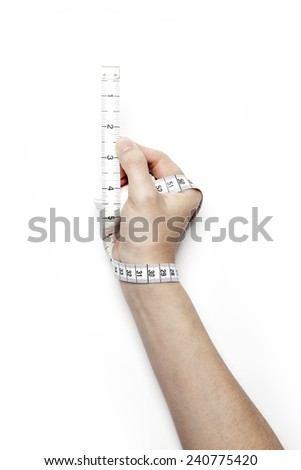 A female(woman) hand hold(reel, coil) a tape measure(tape line) isolated white at the studio.