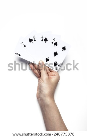 A female(woman) hand hold trump card(spade) isolated white at the studio. - stock photo