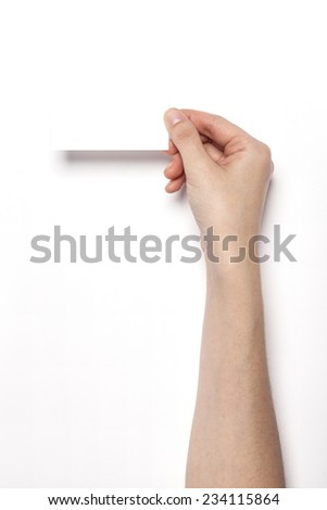 A female(woman) hands hold a empty(blank) white name card isolated white, top view at the studio. - stock photo