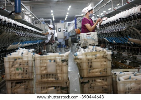 A female worker works in a textile factory in Huaibei, Anhui province, Chin on 19th October 2015.