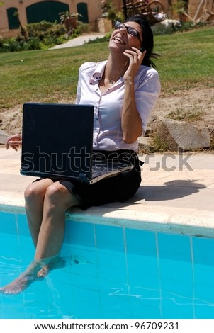 A female working outdoor in a pool - stock photo