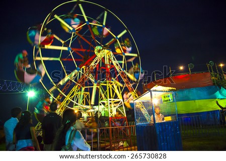 A Ferris Wheel veers by a big folk festival in the famous portuguese Fort in Galle, Sri Lanka - stock photo