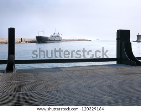A ferry boat in a port - stock photo