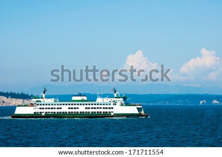 A ferry crosses the puget sound on its daily run - stock photo