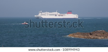 A Ferry steaming out of Holyhead with a small fishing boat nearby Isle of Anglesey North Wales