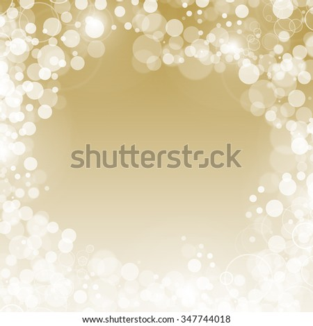 A festive bokeh background in gold and white.