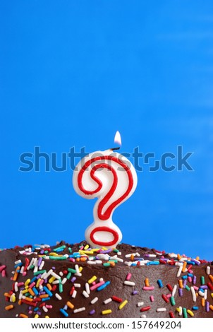 A festive candle to celebrate someones questionable age. - stock photo