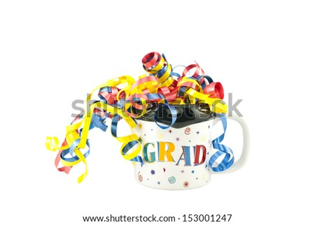 A festive graduation mug filled full of colorful curly ribbons, isolated on a white horizontal background with space for text