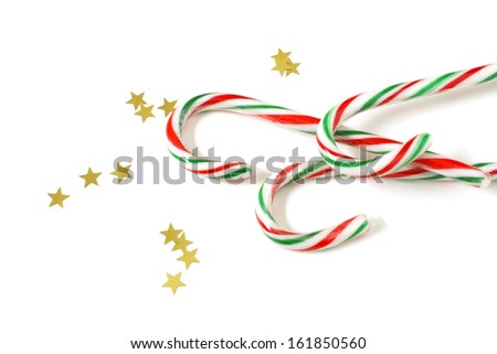 A festive group of delghtful candycanes with star confetti.
