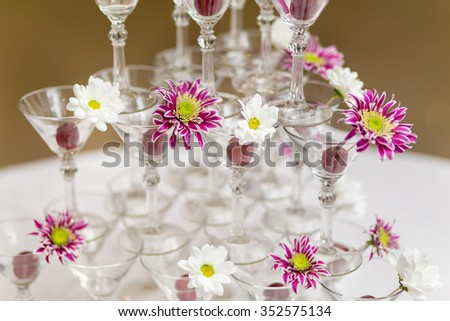 A Festive wineglasses with flowers - stock photo