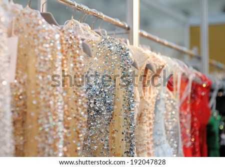 A few beautiful wedding or evening dresses on a hanger  - stock photo