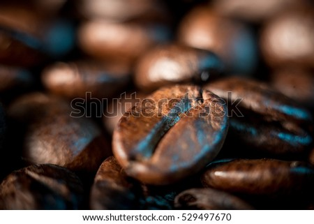 A few coffee beans background, macrophotography .