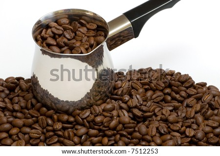 a few coffee beans with a coffee boiler - stock photo