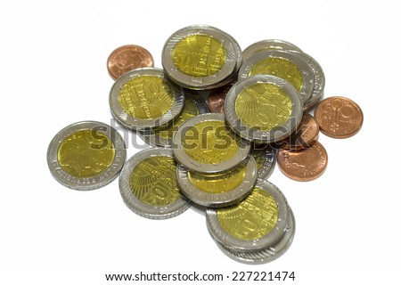 A few coins on a white background - stock photo