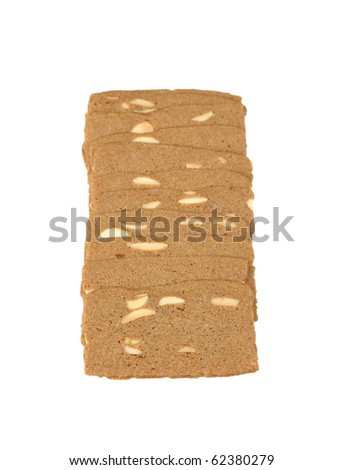 A few cookies with almonds folded in a row. Isolated on white background.