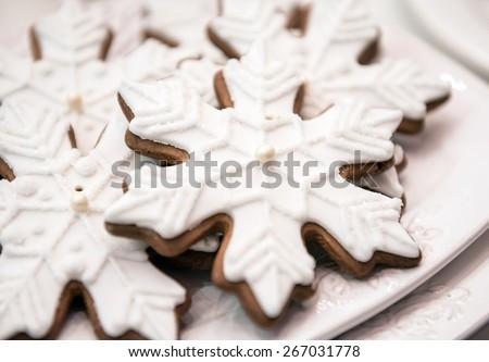 a few gingerbread christmas snowflake cakes - stock photo
