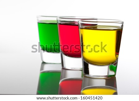 a few glasses of alcoholic drinks in red green yellow