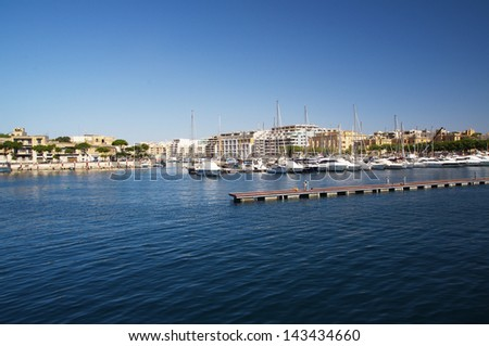a few nice yachts docked at the harbour - stock photo