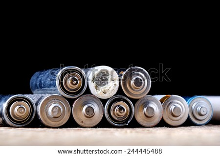 a few old used batteries - stock photo