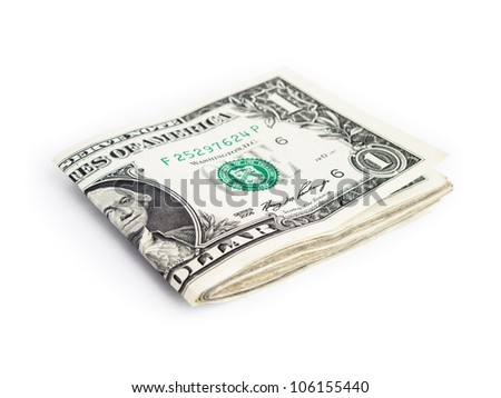 A few one dollar bills folded in half isolated on white background. - stock photo