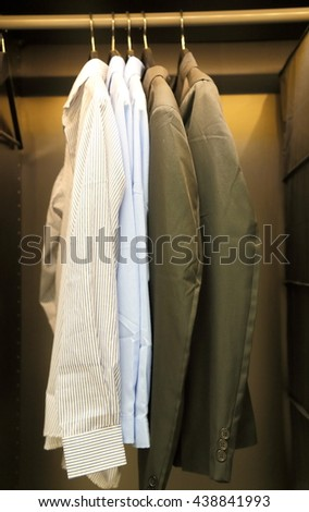 A few pieces of men's shirts in cabinet
