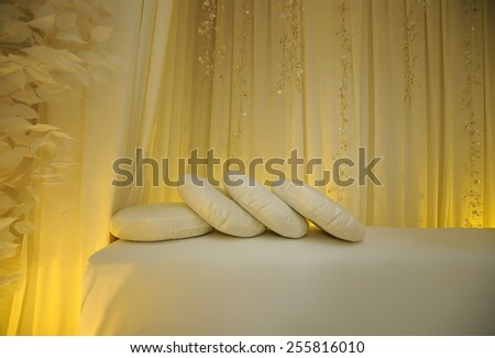 A few pillow on a white bench for a wedding decorations  - stock photo