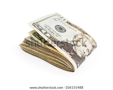 A few twenty dollar bills folded in half and isolated on a white background. - stock photo