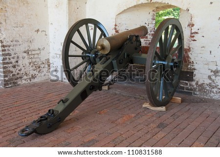 A field howitzer pointed out of a gun port in the casemate of Fort Pulaski on the Savannah River in Georgia. - stock photo