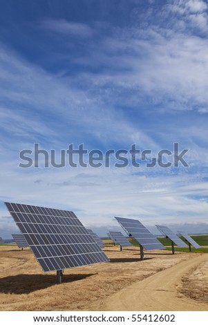 A field of photovoltaic solar panels providing renewable alternative green energy