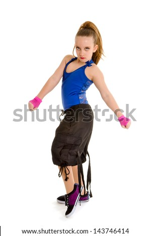 A Fierce Young Girl Poses as a Hip Hop Dancer with Attitude - stock photo