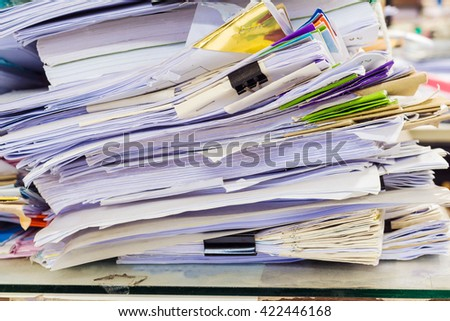 a file folder with documents and important documents - stock photo