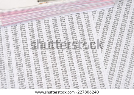 a file folder with documents on a chart number - stock photo