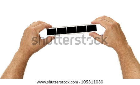 A filmstirp is held by two hands for your images on white - stock photo