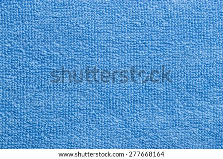 A fine texture of soft light blue cotton bath towe - stock photo