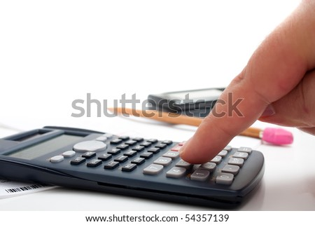 A finger adding up figures using a calculator isolated over a white background. - stock photo