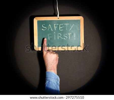 """a finger pointing plate bearing the inscription """"safety first"""" - stock photo"""