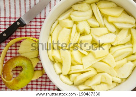 A finished plate and spoon, after eating apple pie a la mode. Part of a series of images showing the preparation of traditional apple pie. Also see my series on the preparation of vanilla ice cream. - stock photo
