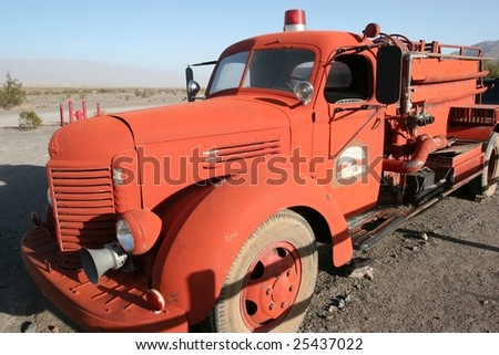 A fire apparatus, fire engine, fire truck, or fire appliance is a vehicle designed to assist in fighting fires, by transporting firefighters to the scene - stock photo