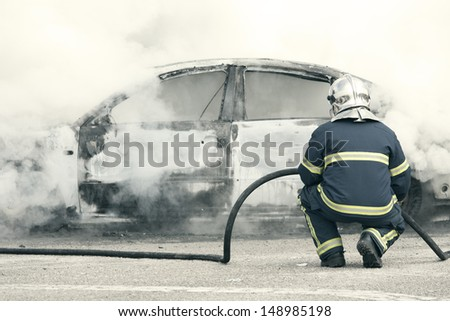 a fire emergency, putting out a fire - stock photo