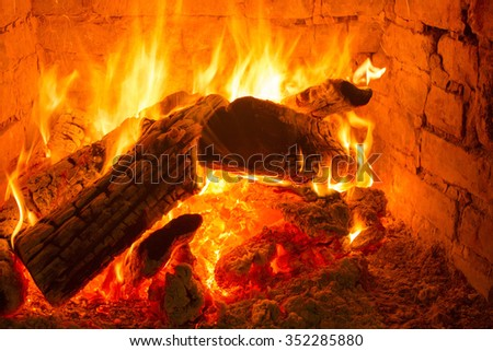 A fire in the fireplace - stock photo