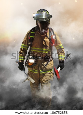 A firefighter pierces through a wall of smoke searching for survivors. - stock photo